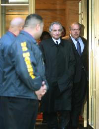 NEW YORK - JANUARY 5:  Financier Bernard Madoff (2nd-R) walks out from Federal Court after a bail hearing in Manhattan January 5, 2009 in New York City. Madoff is accused of running a $50 billion Ponzi scheme through his investment company. Mr. Madoff is free on bail and hasn�t formally responded to the charges or entered a plea.  (Photo by Hiroko Masuike/Getty Images)
